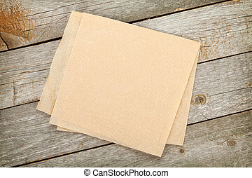 Cooking paper over wooden table background