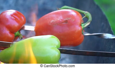 cooking pepper on fire close up