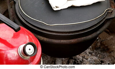Cooking pilaf in a cauldron outside