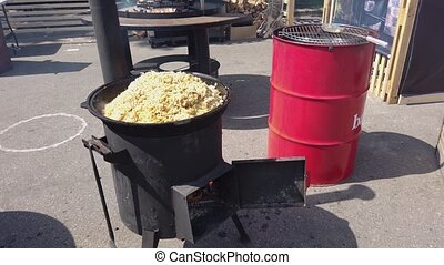 Cooking Pilaf Outdoors In Cauldron - Cooking Pilaf Outdoors...