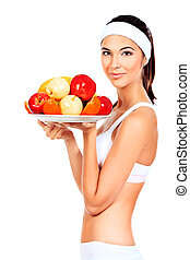 cooking - Portrait of a beautiful young woman with fruits....