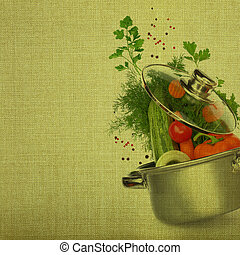 Cooking pot with fresh vegetables on fabric background