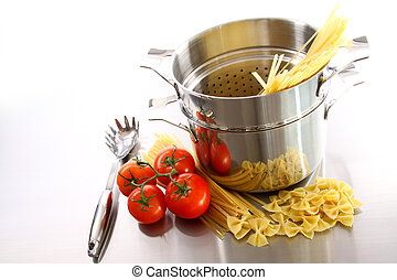 Cooking pot with uncooked pasta and tomatoes - Stainless ...