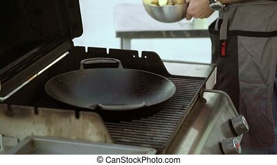 Cooking potato on grill with oil