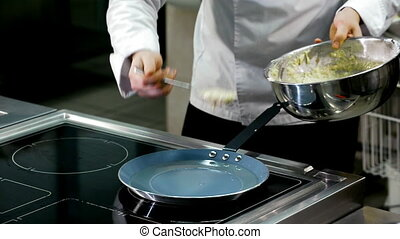 cooking potato pancakes in a frying pan