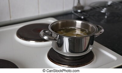Cooking potatoes in boiling water.