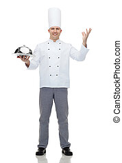 happy male chef cook holding cloche - cooking, profession ...