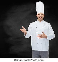 happy male chef cook inviting - cooking, profession and...