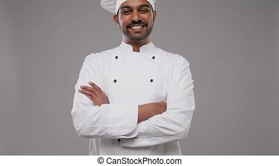 happy male indian chef in toque - cooking, profession and...