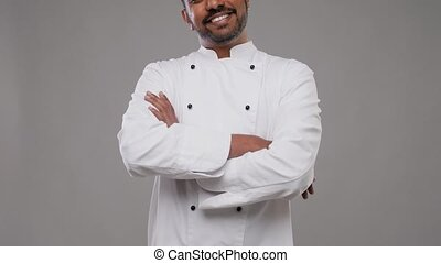 happy male indian chef in white jacket - cooking, profession...