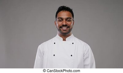 happy smiling male indian chef - cooking, profession and...