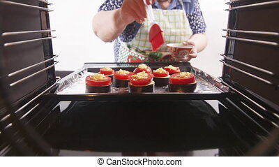 Cooking roasted vegetable dish in electric convection oven.