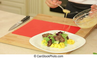 Cooking salad with chicken liver and mango