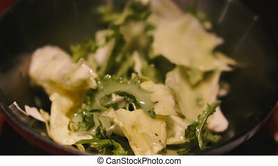 Cooking Salad with herbs and cabbage