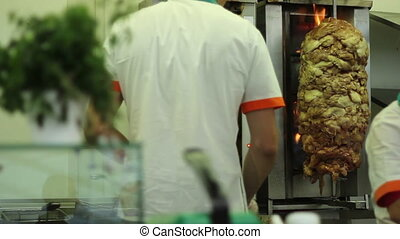 Cooking Shawarma - Cooking meat on rotative fryer for...