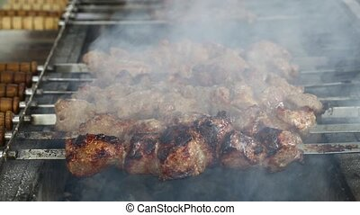 Cooking shish kebab beef meat on grill - Close up of cooking...