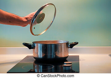 Cooking soup in a pan on an induction stove