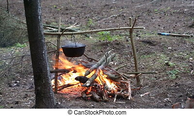 Cooking soup in a pot on the fire