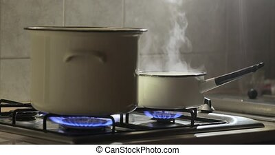 Cooking steam from pot - Cooking on gas stove, steam rising ...