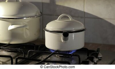 Cooking steam from pot - Cooking on gas stove, steam rising...