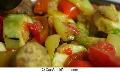 Cooking stewed vegetables - Slow motion extreme close-up...