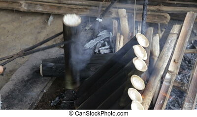 Cooking sugarcane on charcoal