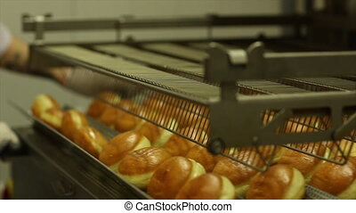 Cooking sweet donuts at the bakery