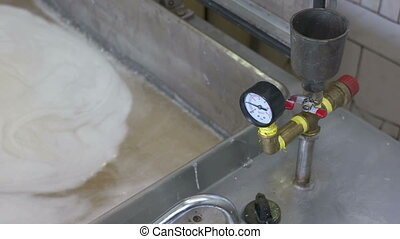 Cooking sweet marshmallow mixture in mixing tank at...