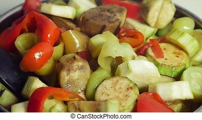 Cooking tasty vegetarian dish - Slow motion close-up shot of...