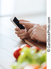 closeup of male hand pointing finger to smartphone