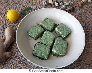 Cooking tofu in green nettles tempura, vegetarian food with...