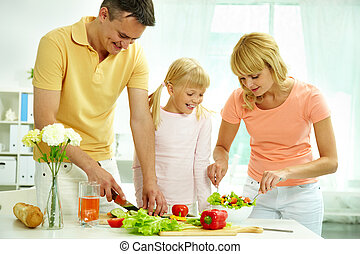 Cooking together - Portrait of happy parents and their ...