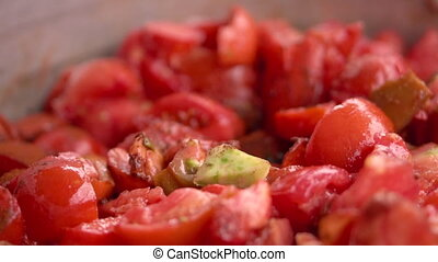 Cooking tomato sauce close-up. Cook add fresh tomato in pan,...