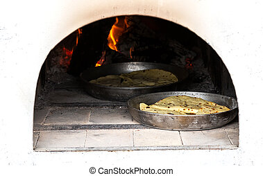 Cooking traditional pies in a Russian oven