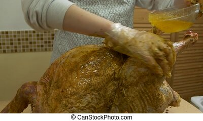 Cooking Turkey Honey - Woman cooks a spice big raw turkey ...