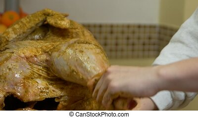 Cooking Turkey Seasoning - Woman cooks a spice big raw...