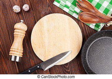 Cooking utensil on wooden table. Top view with copy space