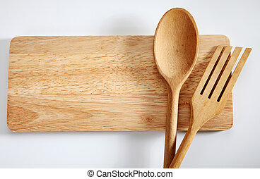 cooking utensil - Wooden spatula and spoon on the chopping ...