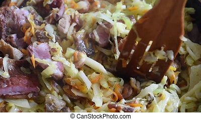 Cooking vegetables in a pan cabbage with meat