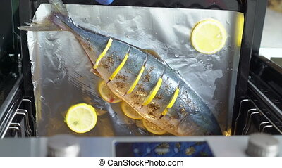 Cooking whole roasted fish seriola with lemon baked in the...