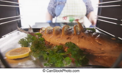 Cooking whole roasted fish seriola with lemon and herbs...