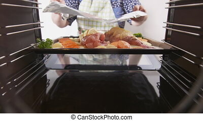 Cooking whole roasted fish with lemon potatoes and herbs...