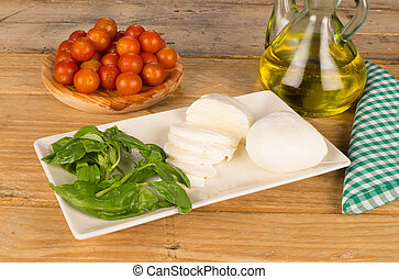 Still life with mozzarella as the main ingredient