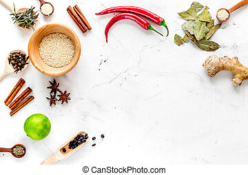 Cooking with spices, salt and pepper on kitchen table background top view mock-up