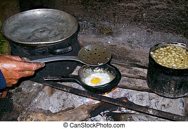 Cooking Woman in A Hut in Peru