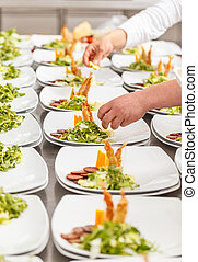 Cooks are preparing delicious appetizer dishes