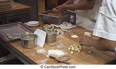 Cooks at Work in a Singapore Restaurant. Video 1080p FullHD...