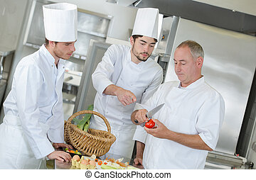 cooks working in a restaurant kitchen