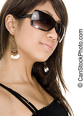 A cool young woman in black sunglasses on white