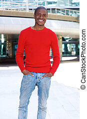 cool african american man smiling in the city